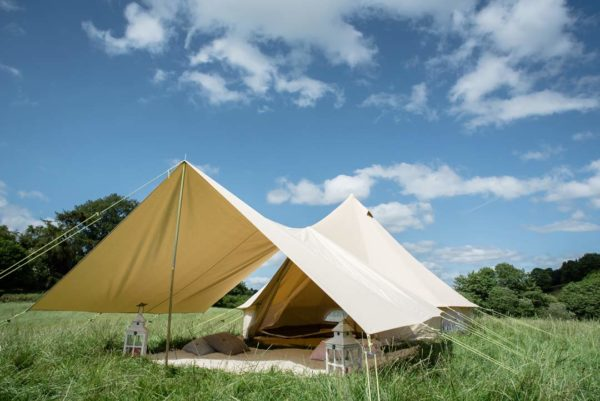 bell tent with awning in a field