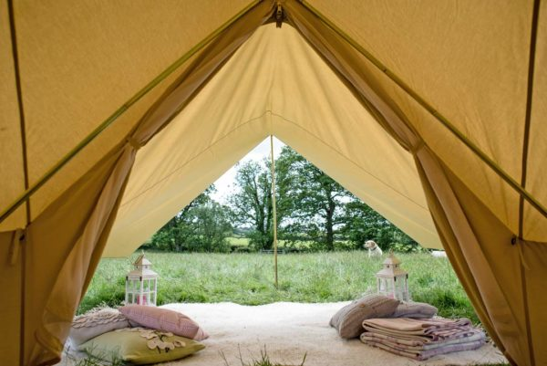 bell tent with awning in field