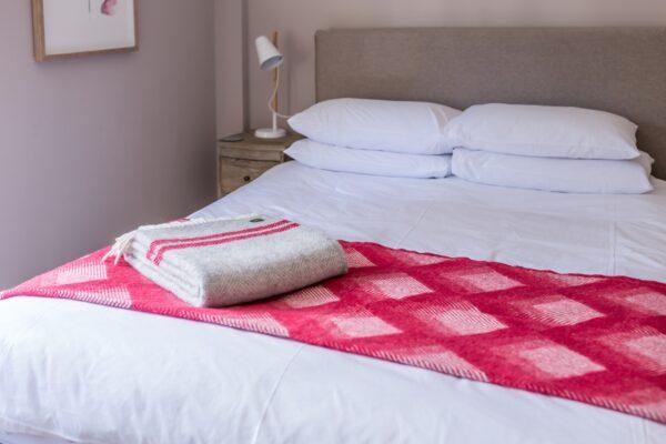 Grey fishbone blanket with watermelon stripe