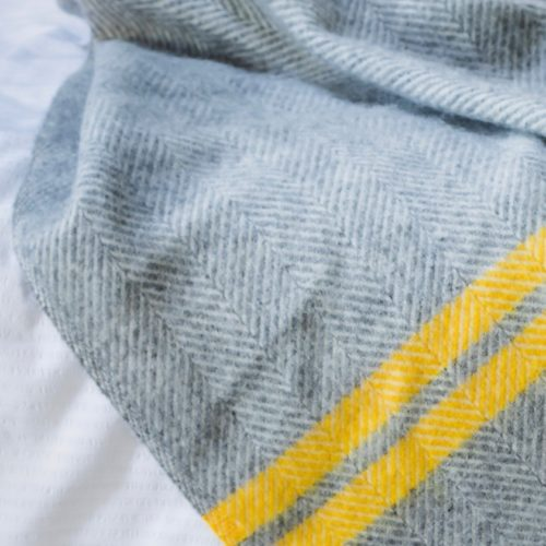 Grey fishbone blanket with yellow