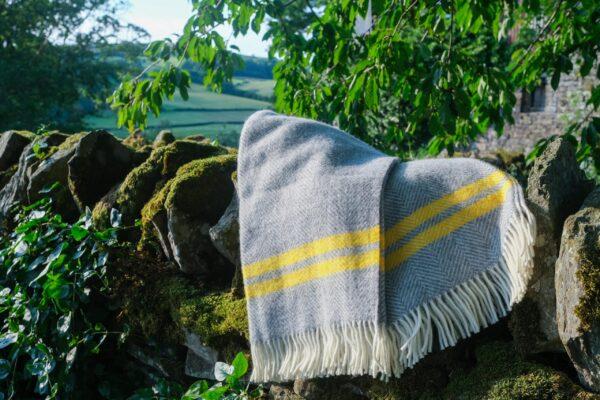 Grey wool blanket with sunshine stripe