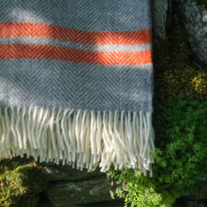 Grey wool blanket with pumpkin orange stripe
