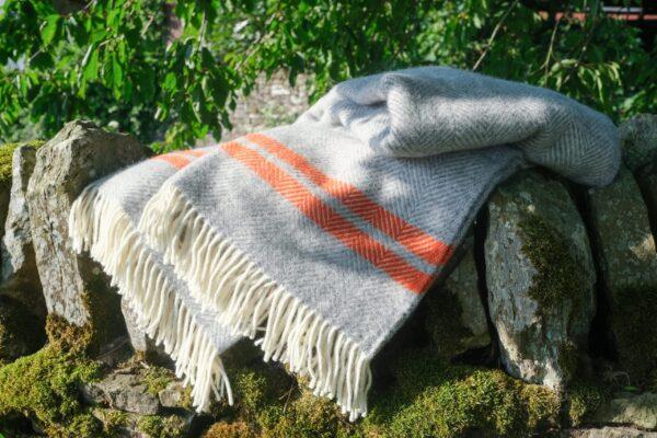 Grey wool blanket with pumpkin orange stripe
