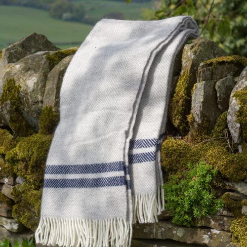Grey fishbone blanket with blue stripe